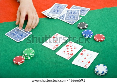 Chips, cards, and the flop during a poker game