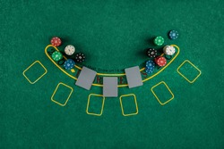 Chips cards lie on a green blackjack table top view. Casino concept, gambling