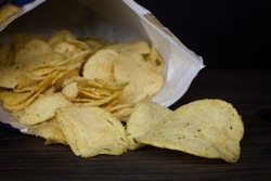 chips close-up in an open package on a dark background.