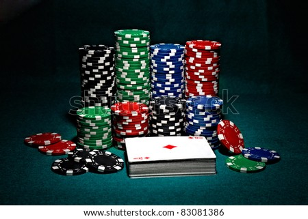 chips for poker with pile of cards