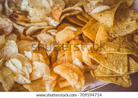 Shutterstock Chips potato on table.