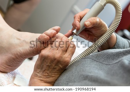 chiropodist gives a treatment of the feet
