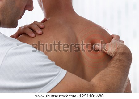 Chiropractic back adjustment. Acupressure Osteopathy, sport injury rehabilitation concept. Male patient suffering from back pain and physical therapist