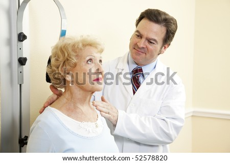 Chiropractic doctor treating an elderly patient for whiplash.