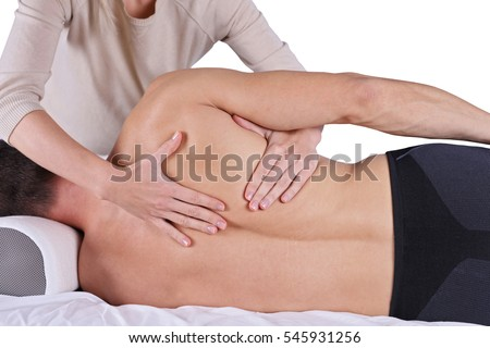 Chiropractic, osteopathy, dorsal manipulation. Therapist doing healing treatment on man's back . Alternative medicine, pain relief concept. Isolated on white