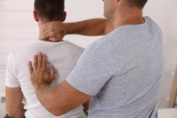 Chiropractic / Osteopathy treatment, Back pain relief. Physiotherapy for male patient, sport injury recovery , Kinesiology