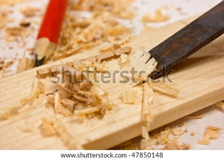 Chisel, sawdust and wood plaque - stock photo