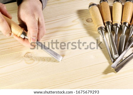 Chisels. Assortment of chisel of wood for carpentry. Hand holding chisel. Stock photo ©