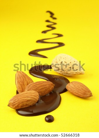 Chocolate almonds on drawing