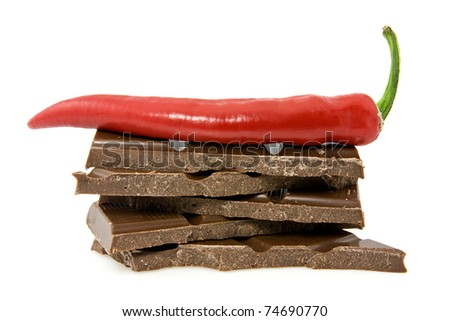 chocolate and chili pepper on white background
