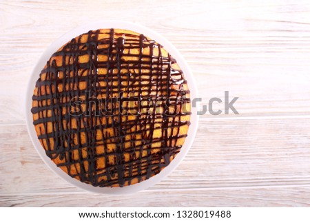 Chocolate and orange drizzle cake, served on plate
