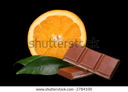Chocolate and orange on the black background.