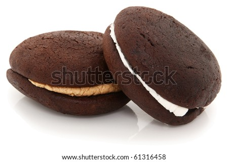 Chocolate And Peanut Butter Whoopie Pies Shot On White Background