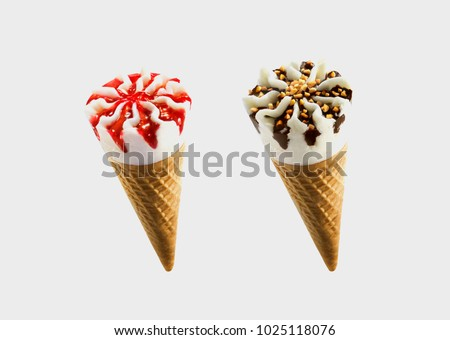Chocolate and strawberry sorts of Ice Cream in a waffles isolated on grey background