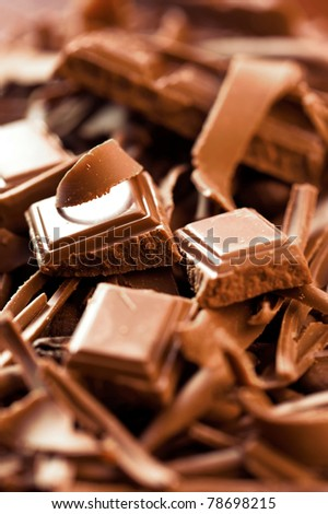 Chocolate background. Bars and strips of chocolate. Shallow depth of field