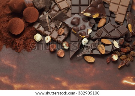 Chocolate background/ nut chocolate/ chocolate bar/ chocolate truffle/ hazelnut