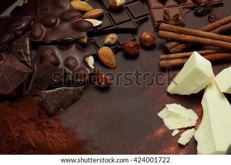 Chocolate background/ nut chocolate/ chocolate bar/ chocolate truffle/ hazelnut #424001722