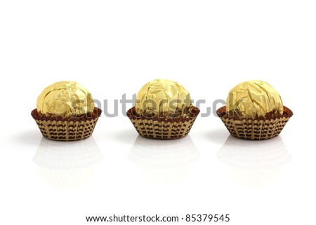 Chocolate ball in foil isolated in white background