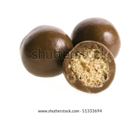 Chocolate balls and a half with crisp filling isolated on white background