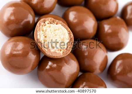 Chocolate balls and a half with crisp filling on white background
