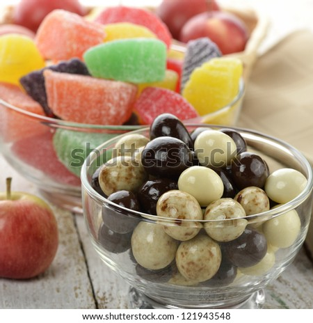 Chocolate Balls And Fruit Candies With Apples