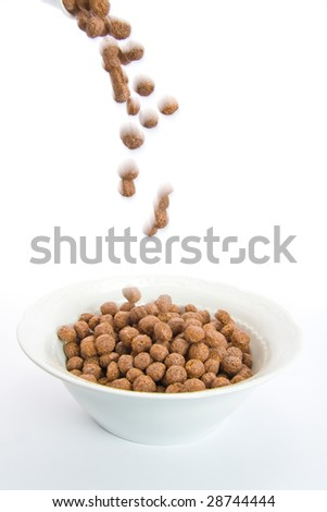 Chocolate balls falling in ceramic bowl-blur representing motion. Isolated on white.