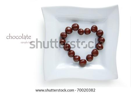 Chocolate balls on a plate, lay a heart-shaped