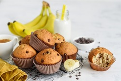 Chocolate banana cupcake muffins on a metal stand on a white background. Selective focus