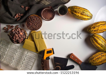 Chocolate bar . Preparing cocao powder / cocao seeds for making chocolate bar on white background with copy space .with copy space .