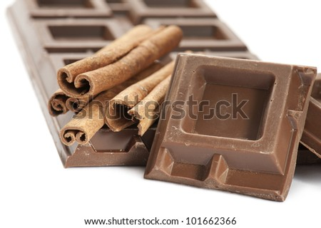 chocolate bar with cinnamon, on white background