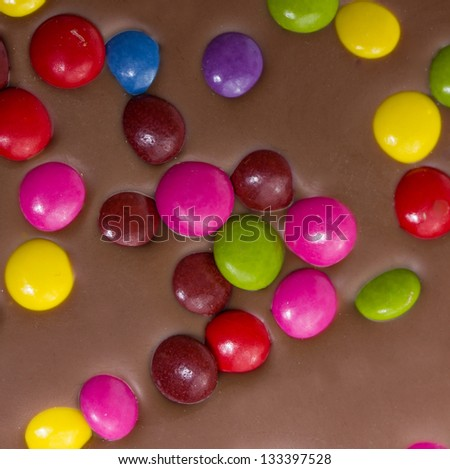 chocolate bar with colorful candy #133397528