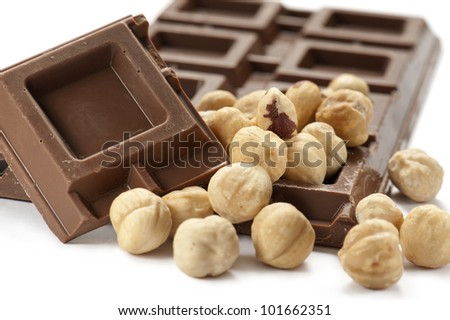 chocolate bar with nuts, on white background