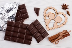 Chocolate bars, plywood heart and spices.