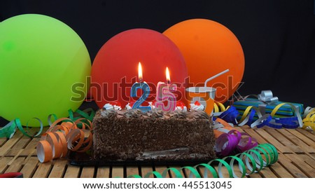 Chocolate Birthday Cake With Candles Burning On Rustic Wooden Table Background Of Colorful Balloons