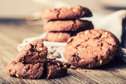 Chocolate biscuit cookies white napkin on wooden table.