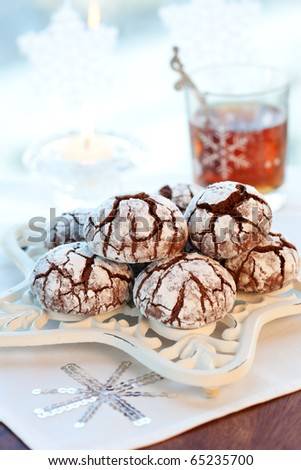 Chocolate biscuits with icing sugar and tea
