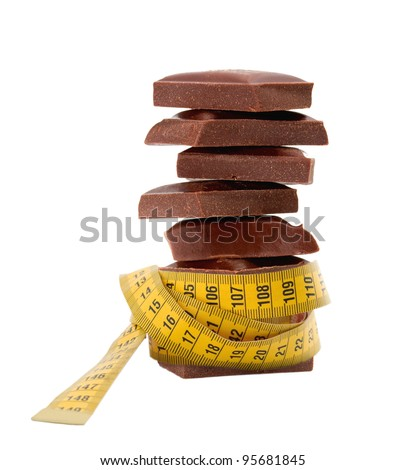 chocolate blocks in tape measure Diet concept - stock photo