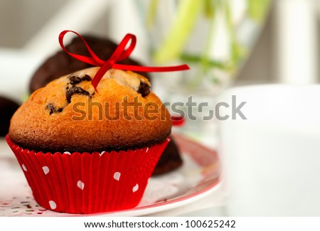 Chocolate-blueberry muffin and coffee cup (selective focus)