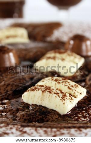 Chocolate bonanza with white chocolate chunks, melted chocolate and cocoa.