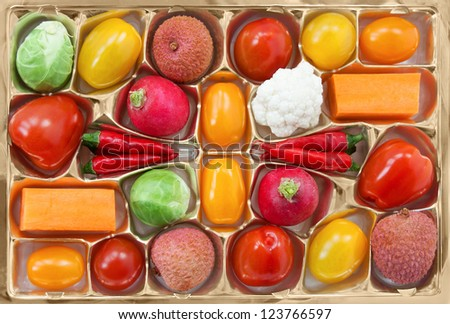 Chocolate box with vegetable and fruit contents - diet concept