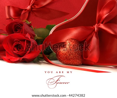 Chocolate boxes with red satin ribbons and roses on white background