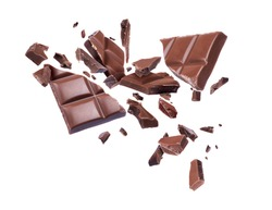 Chocolate broken into pieces in the air on a white background