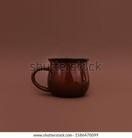 Chocolate brown mug on brown background