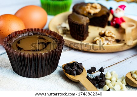 Chocolate Brownie Cake in Paper Cups Decorated with components for making cakes placed on wooden tabs