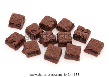 Chocolate brownie cake squares isolated over white background. Selective focus.