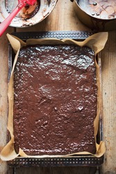 Chocolate brownie dough batter on baking tray,oven ready