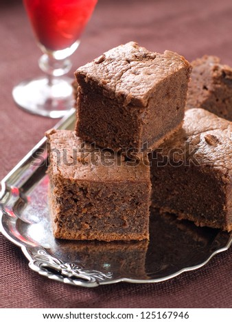 Chocolate brownie on plate, selective focus