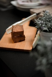 Chocolate brownie squares on cutting board