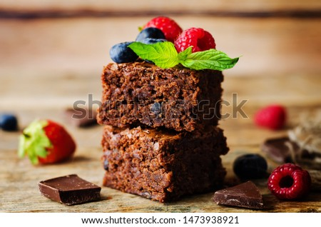 Chocolate brownie with berries and mint leaves. the toning. selective focus #1473938921