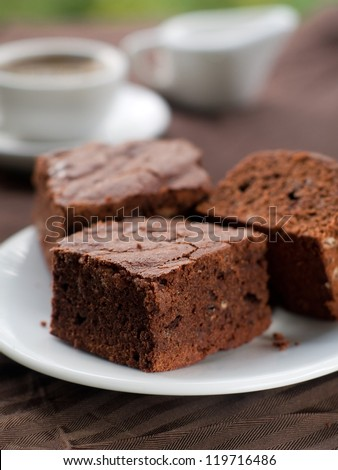 Chocolate brownie with coffee, selective focus